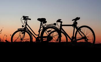 2 bicycles parked during sunset